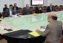 Governor S P Malik chairing a meeting on Wednesday.