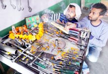 Workers worshipping mechanical tools on the occasion of Vishwakarma Day in Jammu. — Excelsior/Rakesh