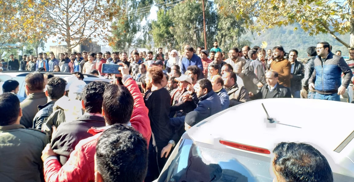 People protesting outside Distt Hospital at Rajouri on Wednesday. —Excelsior/Bhat