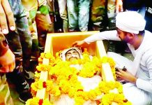 Last rituals being performed by next of kin of Rifleman Varun Kattal at his home town Mawa-Rajpura village on Sunday.