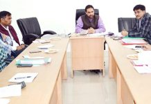 Director Information & Public Relations Tariq Ahmad Zargar chairing a meeting on Monday.
