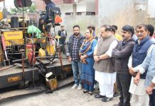 NC Provincial President & MLA Devender Singh Rana kick-starting macadamization of road in Sidhra on Wednesday.