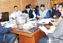 Principal Secretary Finance, Navin K Choudhary chairing a meeting in Jammu on Monday.