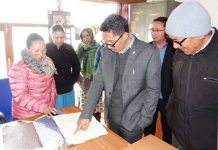 CEC Leh checking atendance register in an office during surprise inspection on Tuesday.