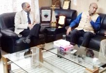 G Parthasarathi in discussion with Dr Nirmal Singh at Jammu on Friday.