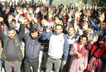 PHE daily wagers staging protest demonstration at Press Club in Jammu on Monday. -Excelsior/ Rakesh