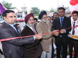 Dignitaries inaugurating Adhaar Upland Tyres on Roop Nagar-Janipur road on Wednesday. — Excelsior/Rakesh