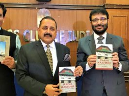 """Union Minister Dr Jitendra Singh, flanked by DG Prasar Bharati Fayyaz Shehryar, releasing the book titled """"Radio Kashmir: In times of peace & war"""" written by Rajesh Bhat, at Press Club of India, New Delhi on Tuesday."""