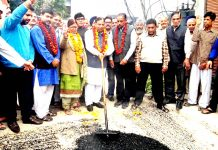MLA Jammu West, Sat Sharma kickstarting blacktopping of road in Ward No. 40 on Sunday.