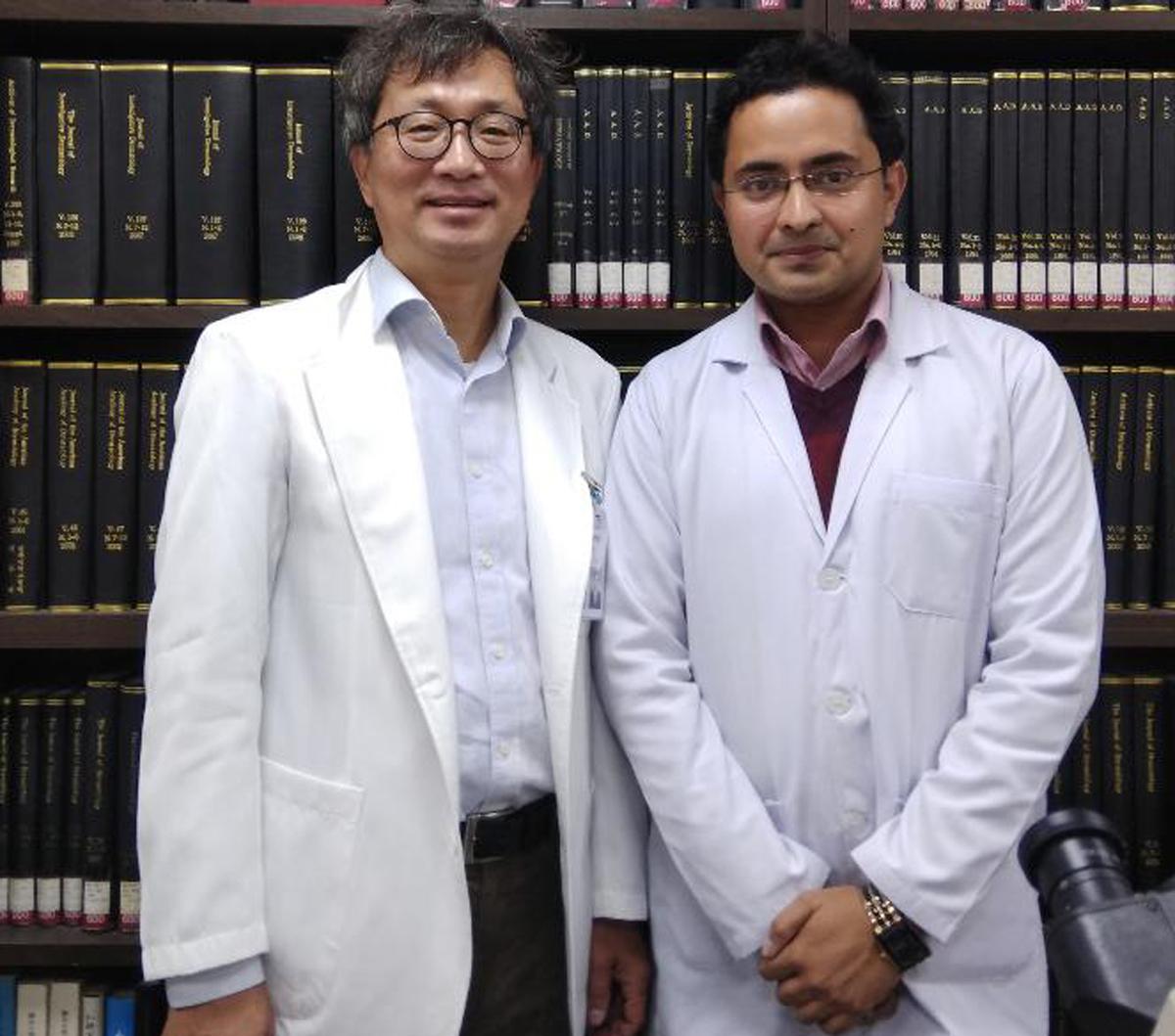 Dr Mrinal Gupta posing with a member of Korean Dermatological Association.