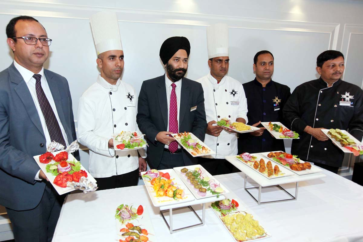 Chefs and officials of KC Residency displaying cuisines on Saturday. -Excelsior/Rakesh