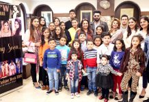 Kids and models posing after rehearsals and auditions of Jammu Fashion Week at Amar Singh Club, Jammu.
