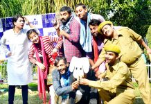 A scene from the play 'Girgit' staged by Natrang at Jammu on Sunday.
