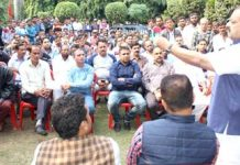 NC Provincial President Devender Singh Rana interacting with a delegation of daily rated workers on Friday.