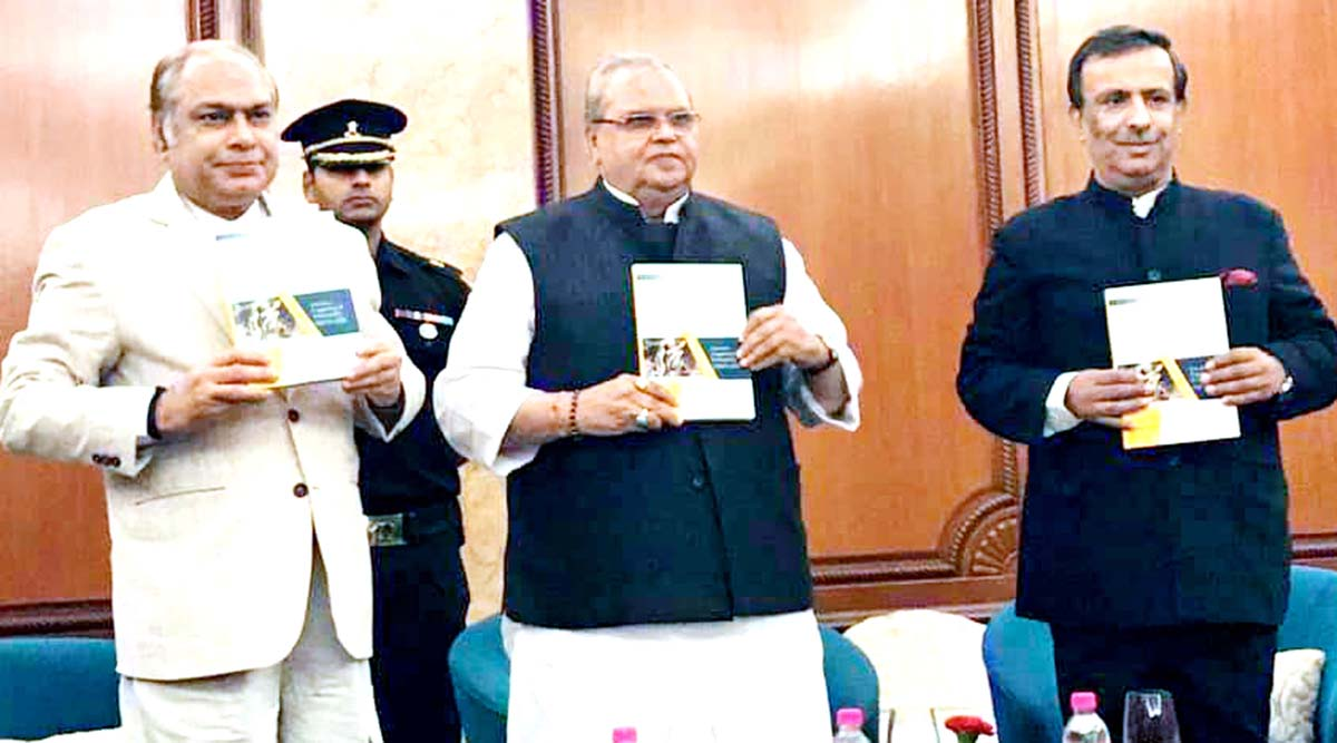 Governor, SP Malik along with vice chancellor, Prof Yogesh Tyagi of Delhi University releasing Prof Amitabh Mattoo's book at New Delhi on Sunday. The author is also seen in the picture.
