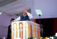 Prime Minister Narendra Modi addressing a rally after inaugurating the Kundali- Manesar section of the Western Periferal Express Way, at Sultanpur in Gurugram on Monday. (UNI)