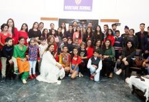Aspiring candidates of Jammu Fashion Week posing for a group photograph after Catwalk Training at Jammu on Sunday.