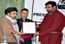 Chairman Legislative Council Haji Anayat Ali being presented a souvenir on occasion of inauguration of Press Club of Kargil on Thursday.