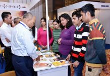 Visitors enquiring about various tour packages from representatives of tourism industry during ITM Jammu on Saturday.