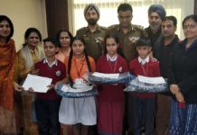Chairperson, PWWA, Dr Rubinder Kaur, posing with students of Police Public School, Miran Sahib, who bagged prizes in State level painting competition.