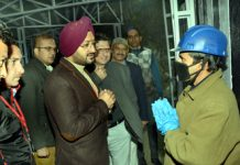 Simrandeep Singh, CEO, SMVD Shrine Board, interacting with a staff member at Sanjichhat.