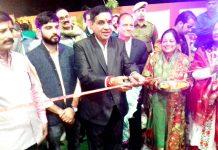 JMC Mayor, Chander Mohan Gupta inaugurating marriage hall at Vijaypur on Monday.