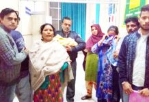 Family members of a newly born child who died due to the negligence of Hospital staff wailing in the premises of DH Kathua on Monday. -Excelsior/Pardeep