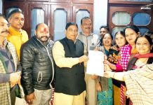 Former Minister & MLA Jammu West, Sat Sharma handing over a letter for release of CDF to residents of Ward 18 on Monday.