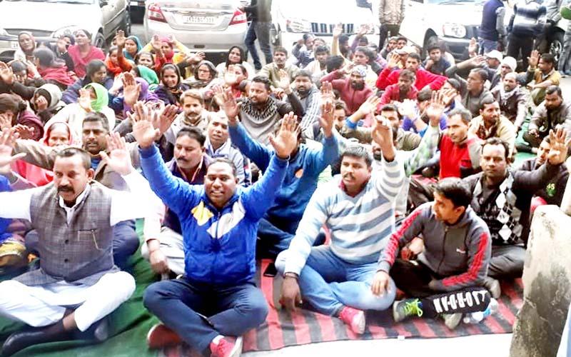 Civic Safaikaramcharis during a protest demonstration in Jammu on Thursday.