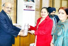 Secretary Department of Rural Development & PR, Sheetal Nanda handing over a glass-made water bottle to Chief Secretary BVR Subrahamanyam in Civil Secretariat at Jammu on Tuesday.