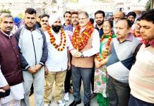 Former Deputy CM and MLA Gandhi Nagar, Kavinder Gupta with residents of Gandhi Nagar after starting blacktopping of road on Tuesday.
