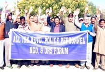 Members of Retired Police Personnel Forum protesting at Vijaypur on Tuesday.