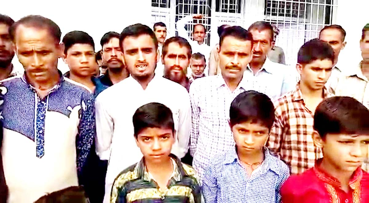 Villagers protesting against non-availability of doctors at PHC, Ladana in Ramnagar. -Excelsior/ K Kumar
