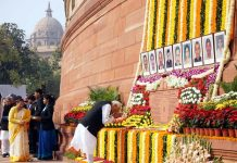 Prime Minister Narendra Modi paying homage to martyrs of Parliament attack at Parliament house, in New Delhi on Thursday. (UNI)