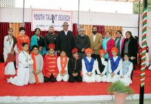 Participants of Inter-School Skit Competition and dignitaries posing for group photograph.