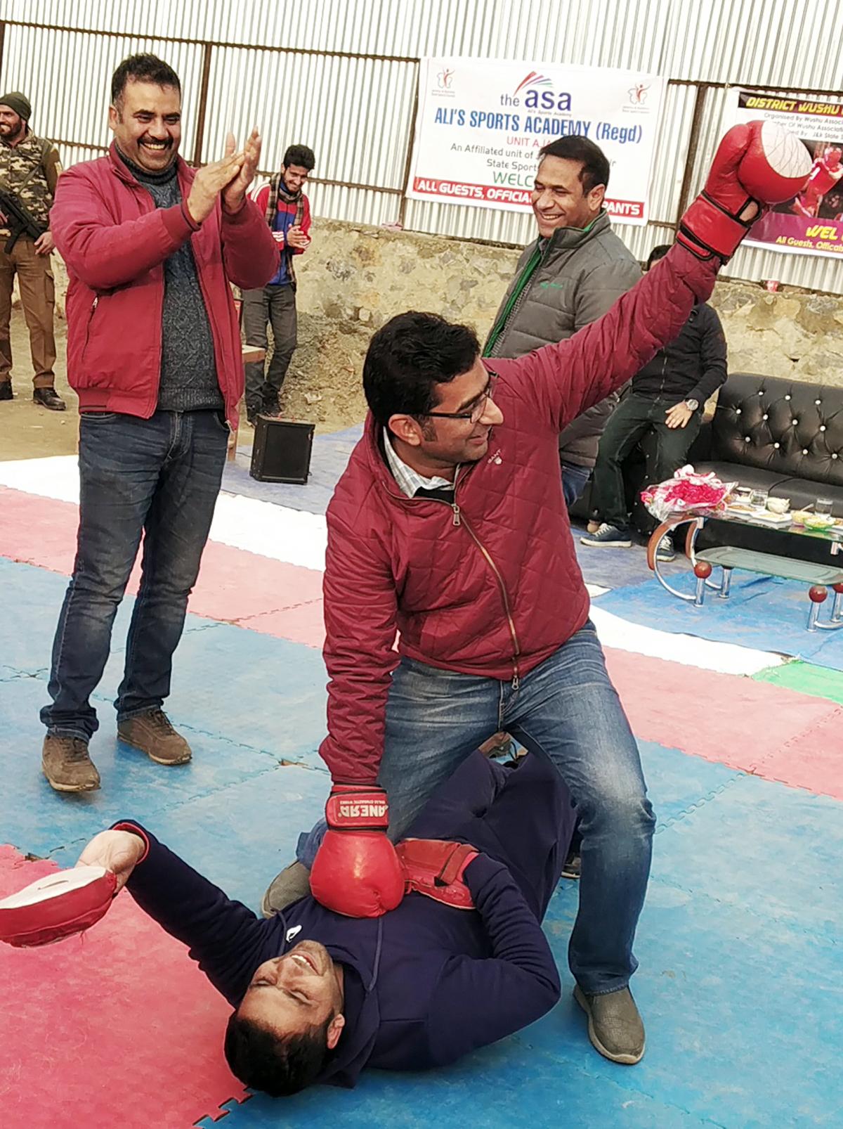 DDC Bandipora Dr Shahid Iqbal Choudhary trying his Wushu skills after inaugurating 9th District Wushu Championship at Ajas.