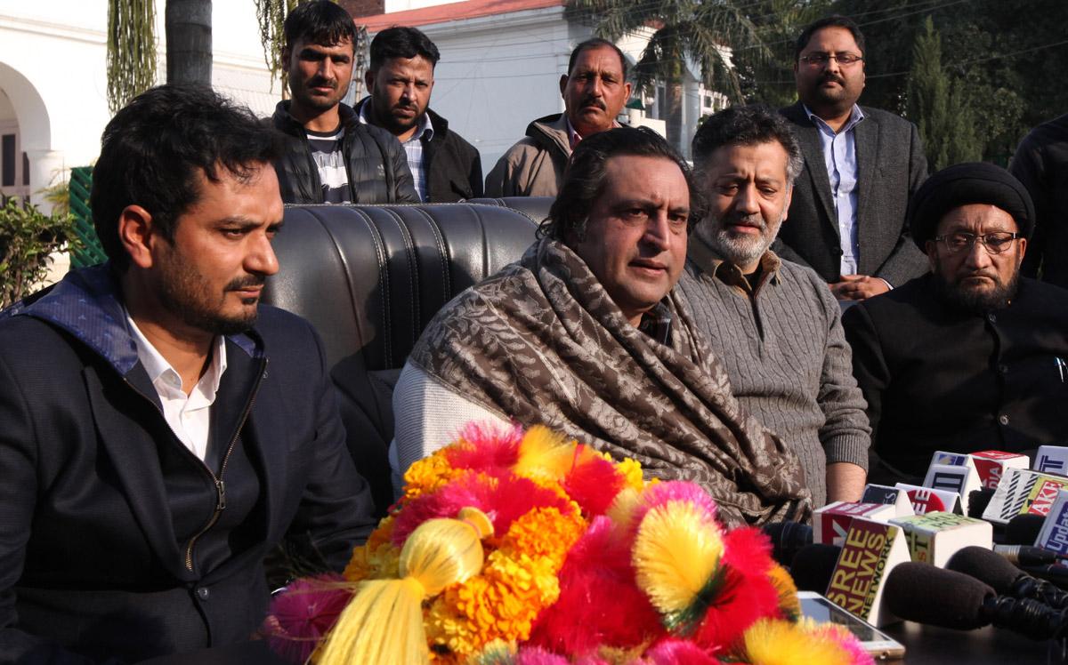 PC chairman, Sajjad Gani Lone and another senior leader Imran Raza Ansari at a press conference at Jammu on Sunday. —Excelsior/Rakesh