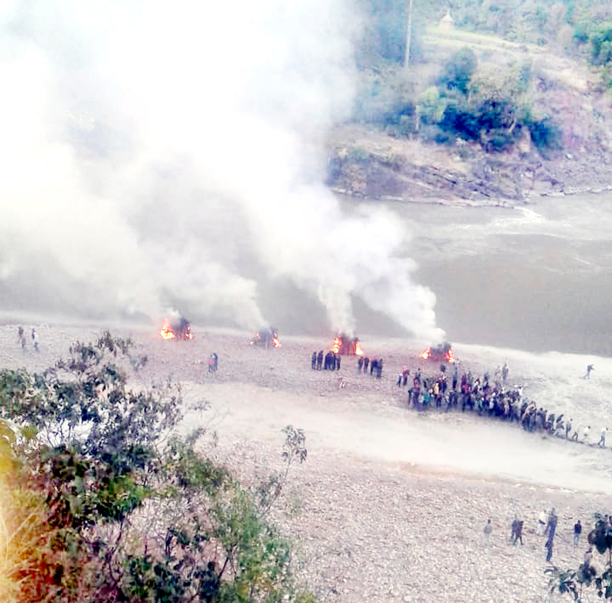 Mass cremation of deceased in the accident being performed in their native village on Friday.