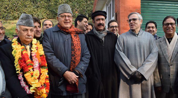 NC leaders Farooq Abdullah and Omar Abdullah posing with Basharat Bukhari and Peer Mohammad Hussain in Srinagar on Wednesday. -Excelsior/Shakeel