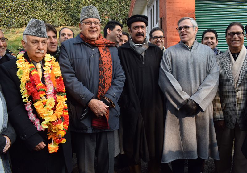 NC leaders Farooq Abdullah and Omar Abdullah posing with Basharat Bukhari and Peer Mohammad Hussain in Srinagar on Wednesday. -Excelsior/Shakeel