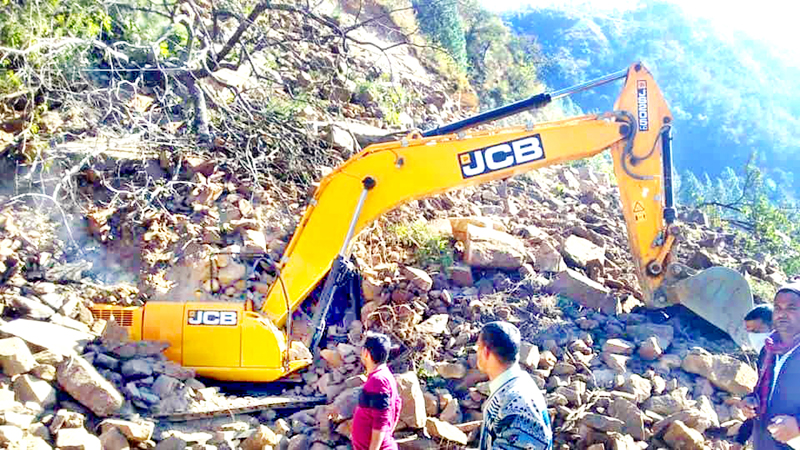 An earth-moving machine at the site of a landslide, which left at least seven labourers dead in Uttarakhand's Rudraprayag district on Friday.