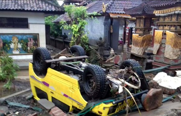 A car over-turned after tsunami struck off the Sunda Strait, in Indonesia on Sunday. (UNI)