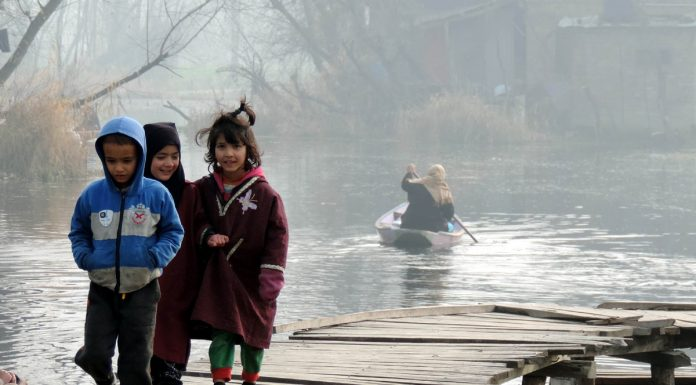 Children enjoying their winter vacations on the interiors of Dal lake in Srinagar on Thursday. (UNI)