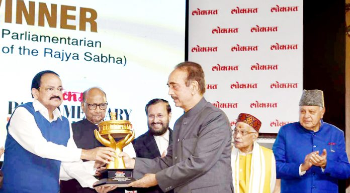 Vice President M Venkaiah Naidu presenting the 'Best Parliamentarian Award' to Ghulam Nabi Azad in New Delhi on Thursday.Union Minister for Human Resource Development, Prakash Javadekar and former Chief Minister of J&K Dr Farooq Abdullah and other dignitaries are also seen.