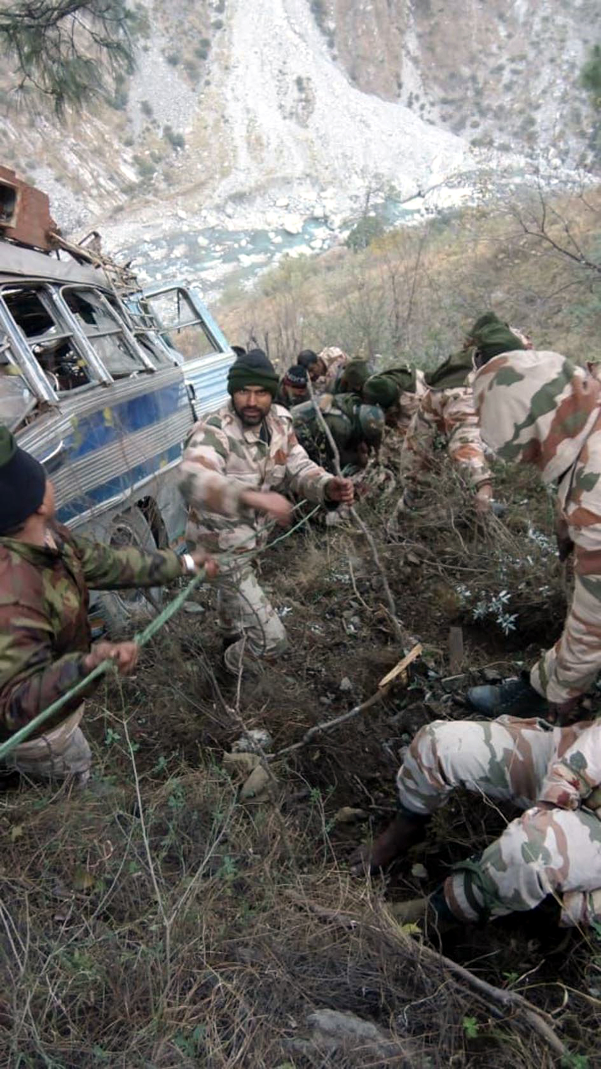 Rescue work in progress after a bus carrying ITBP personnel rolls down into a gorge at Khooni Nallah in Ramban on Monday. (UNI)