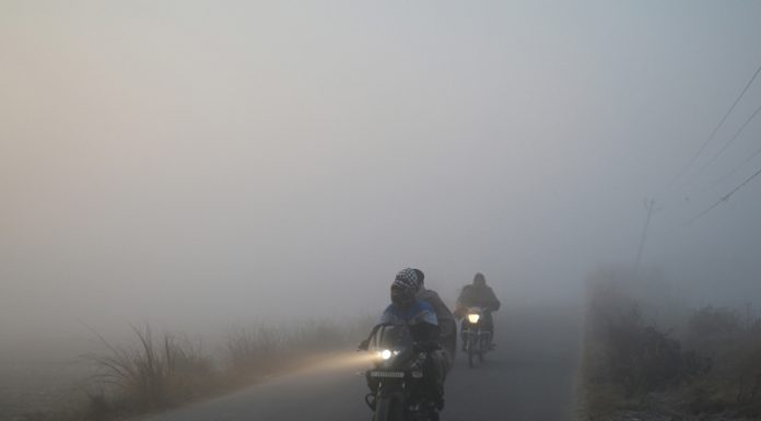 Bikers move during a foggy morning on the outskirts of Jammu on Thursday. -Excelsior/Rakesh