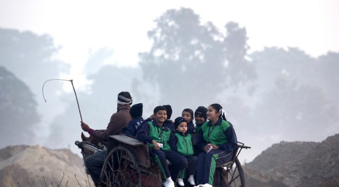 Children on way to school on a horse driven cart on the outskirts of Jammu. -Excelsior/Rakesh