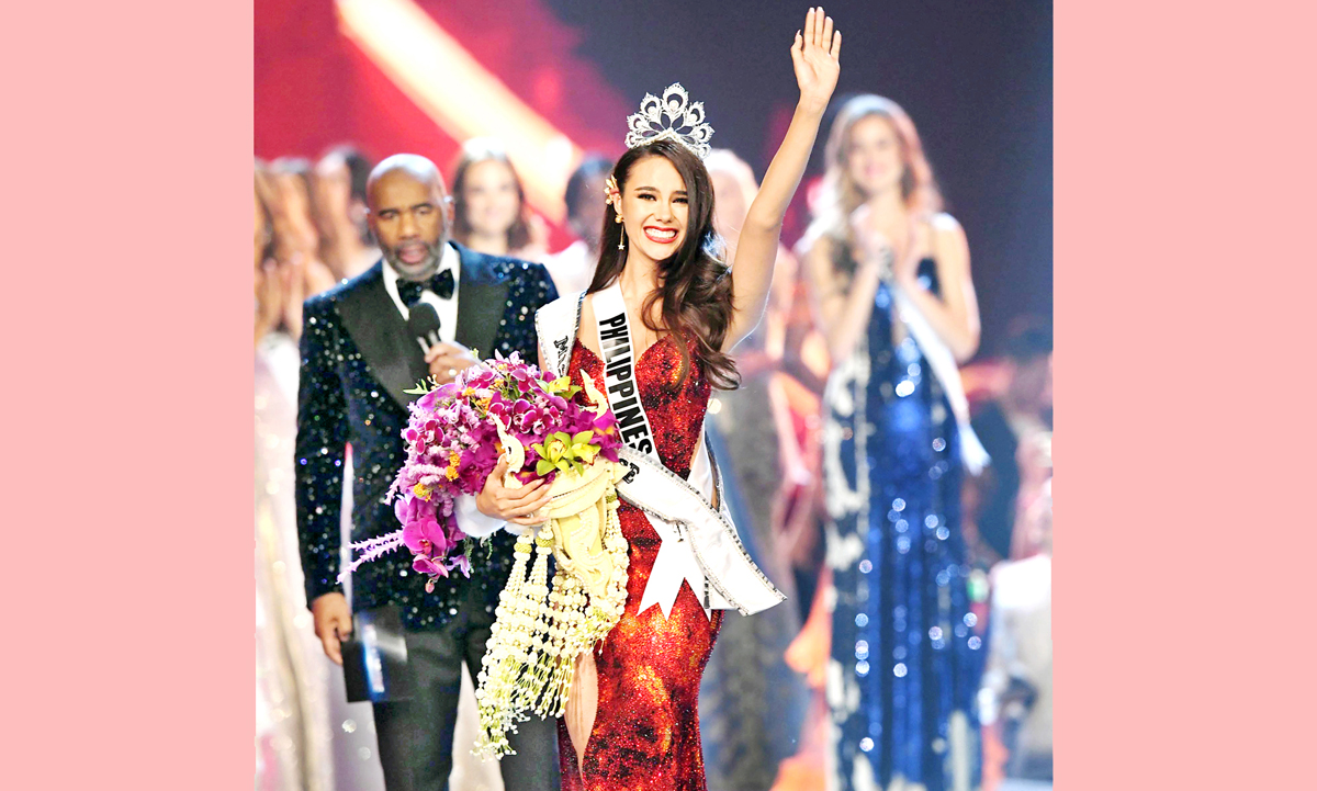 Miss Philippines Catriona Gray jubilates after being crowned as the new Miss Universe 2018 in Bangkok, Thailand on Monday. (UNI)