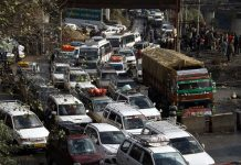 Stranded vehicles, being cleared towards Kashmir, caught in jam at Ramban on Thursday. -Excelsior/Parvaiz Mir