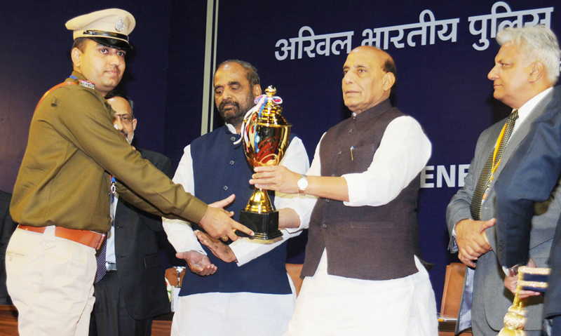 Union Home Minister Rajnath Singh presenting trophy to a police officer at Conference of DGs and IGPs at Kevadiya, Narmada in Gujarat on Thursday.